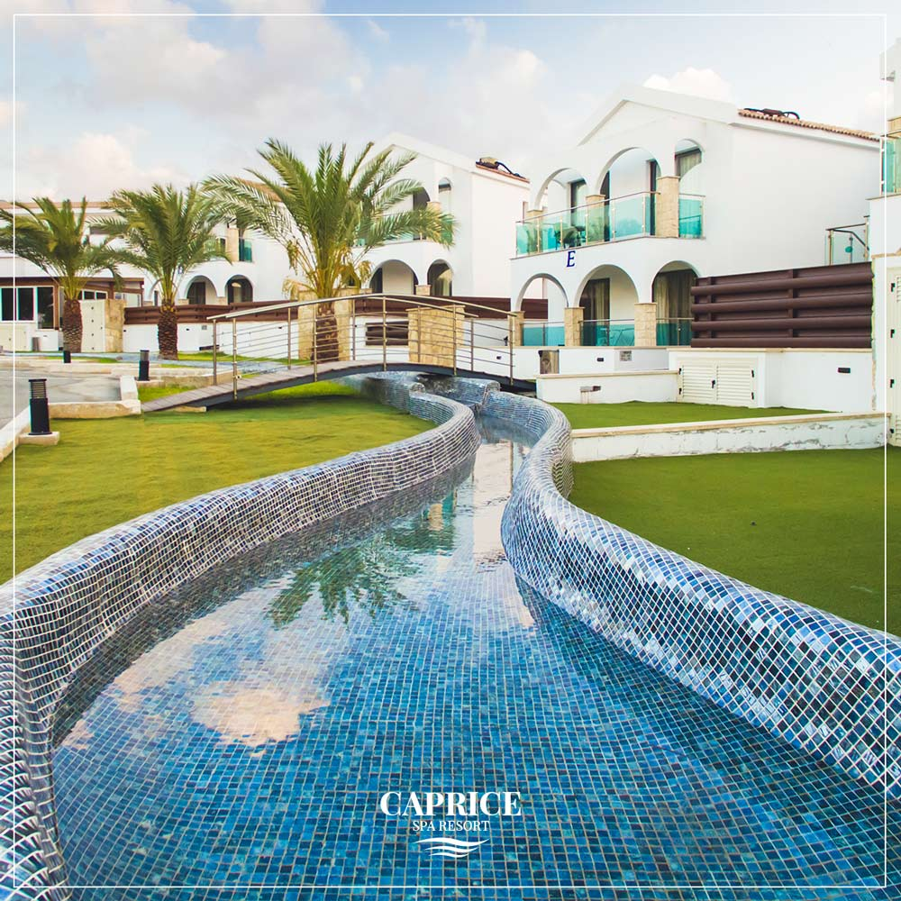 A beautiful view of a swimming pool in Caprice Spa Resort in Latchi, Cyprus
