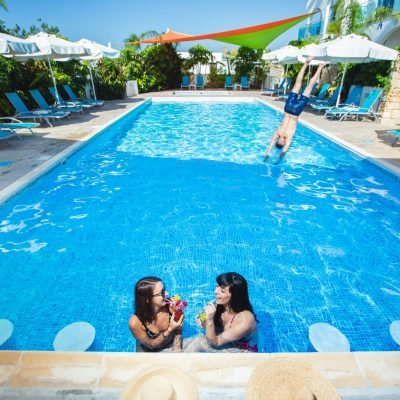 two girls enjoying cocktails in the pool in Latchi